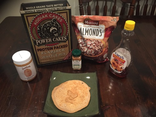 1 large pancake, about 6 inches diameter, along with all of the ingredients used to make it: Justin's Peanut Butter, Kodiak Power Cakes pancake mix, organic cinnamon, Mariani sliced almonds, Cary's sugar-free syrup